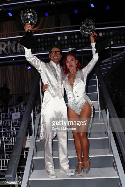 Mirrorball trophy winners Bobby Bones and Sharna Burgess pose at Dancing with the Stars Season 27 Finale at CBS Television City on November 19 2018...