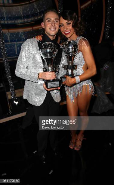 Mirrorball trophy winners figure skater Adam Rippon and dancer/TV personality Jenna Johnson pose at ABC's Dancing with the Stars Athletes Season 26...