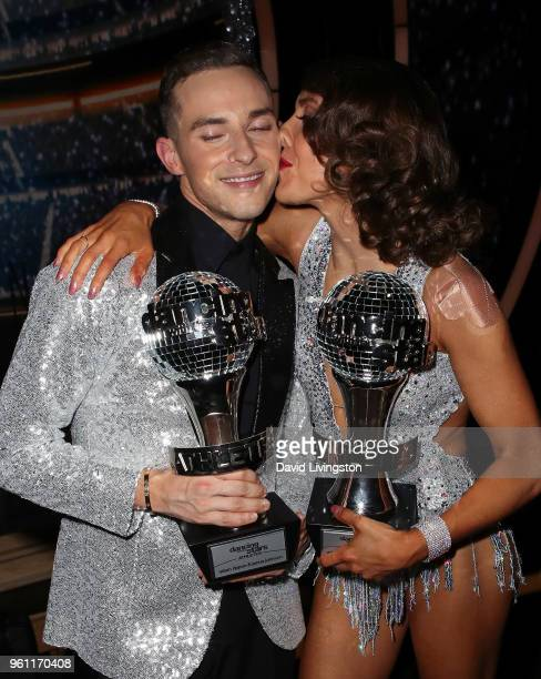 Mirrorball trophy winners figure skater Adam Rippon and dancer/TV personality Jenna Johnson pose at ABC's 'Dancing with the Stars Athletes' Season 26...