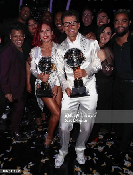 Mirrorball trophy winners Sharna Burgess and Bobby Bones pose at 'Dancing with the Stars' Season 27 Finale at CBS Television City on November 19 2018...