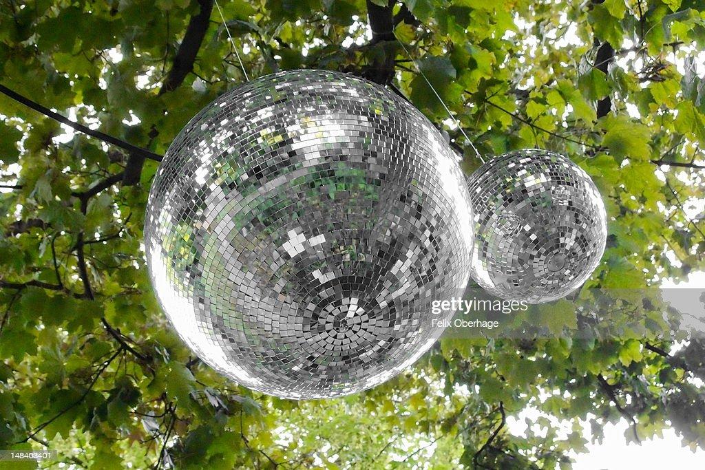 Mirror-balls hanging on  tree : Stock Photo