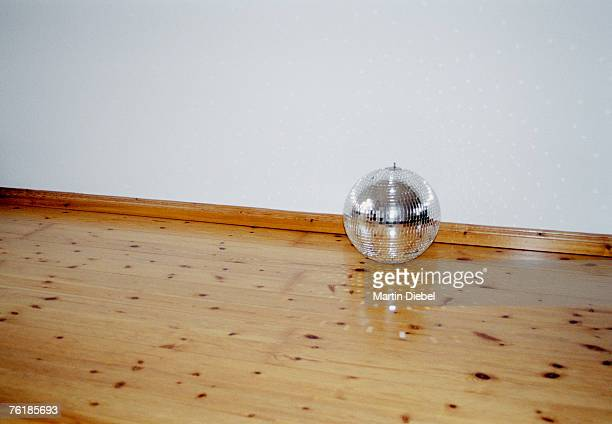 Mirrored disco ball on a hardwood floor