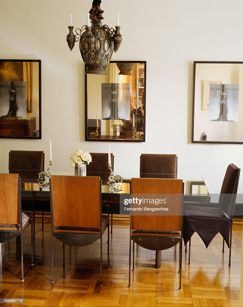 Mirrored Frames And Tabletop In Dining Room Stock Photo