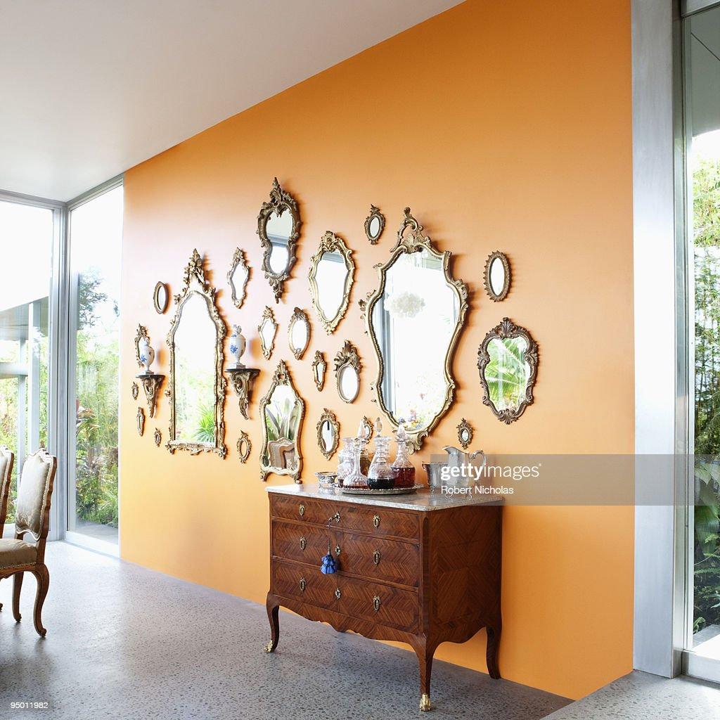 Mirrors on orange wall : Stock Photo