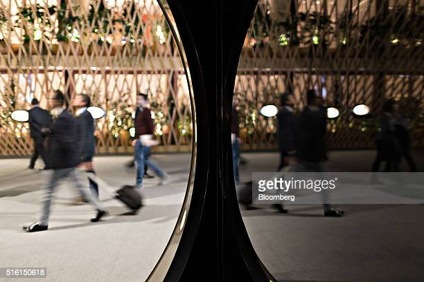 Mirrors reflect attendees at the 2016 Baselworld luxury watch and jewelry fair in Basel Switzerland on Thursday March 17 2016 1500 companies from the...