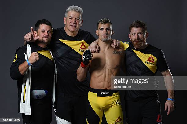 Mirsad Bektic of Bosnia poses for a post fight portrait with his team backstage during the UFC 204 Fight Night at the Manchester Evening News Arena...