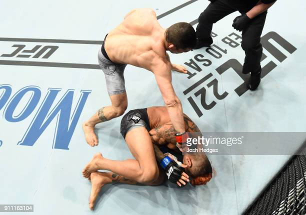 Mirsad Bektic of Bosnia punches Godofredo Pepey of Brazil in their featherweight bout during a UFC Fight Night event at Spectrum Center on January 27...