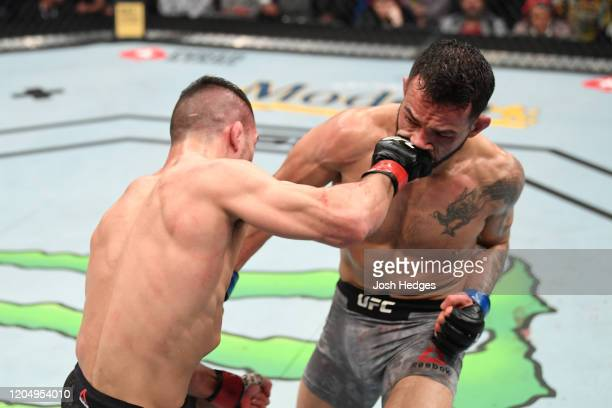 Mirsad Bektic punches Dan Ige in their featherweight bout during the UFC 247 event at Toyota Center on February 08, 2020 in Houston, Texas.