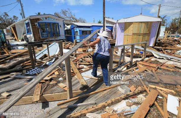Mirta Mendez walks through the debris at the Seabreeze trailer park along the Overseas Highway in the Florida Keys on Tuesday, Sept. 12, 2017.