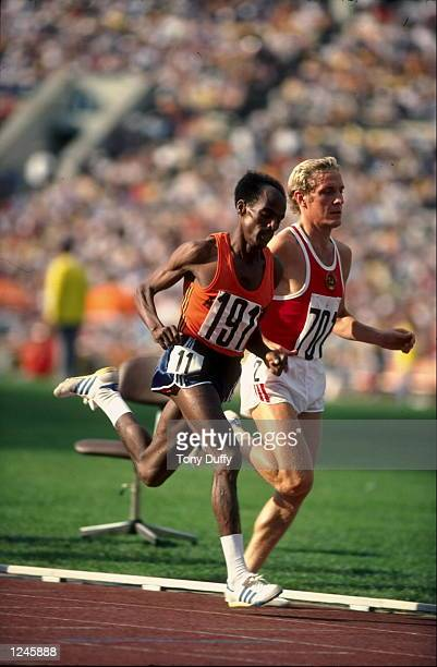 Miruts Yifter of Ethiopia passes Aleksandr Fedotkin of the Soviet Union in the 5 000 metres final at the 1980 Olympic Games at the Lenin Stadium in...