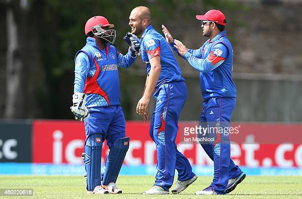 Mirwais Ashraf of Afghanistan celebrates after bowling out Shaiman Anwar of UAE during the ICC World Twenty20 India Qualifier between UAE and...