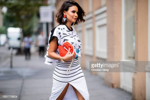 Miryam Labiad wearing Adi Yair skirt and top orange bag volta atelier earring LCStudios is seen during New York Fashion Week Spring/Summer 2019 on...