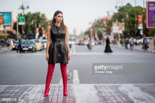 Miryam Labiad wearing black leather dress Alaia red boots Fendi red gloves on November 2 2017 in Marrakech Morocco