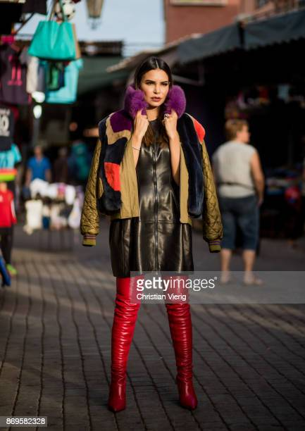 Miryam Labiad wearing black leather dress Alaia red boots Fendi red gloves jacket on November 2 2017 in Marrakech Morocco