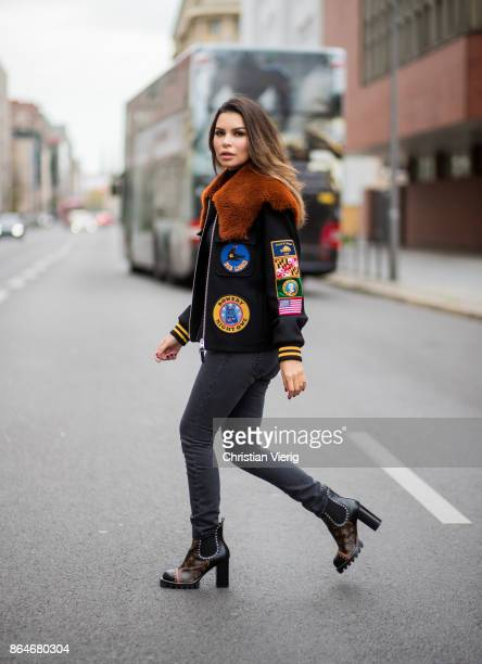 Miryam Labiad wearing Coach jacket grey skinny jeans Current Elliot Louis Vuitton boots on October 21 2017 in Berlin Germany