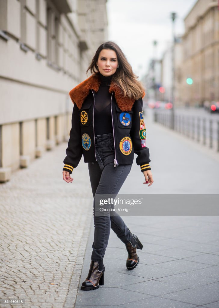 Miryam Labiad wearing Coach jacket, grey skinny jeans Current Elliot, Louis Vuitton boots on October 21, 2017 in Berlin, Germany.