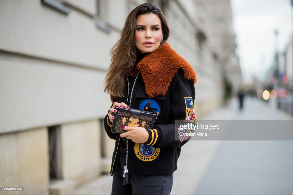 Miryam Labiad wearing Coach jacket, grey skinny jeans Current Elliot, Louis Vuitton bag clutch on October 21, 2017 in Berlin, Germany.