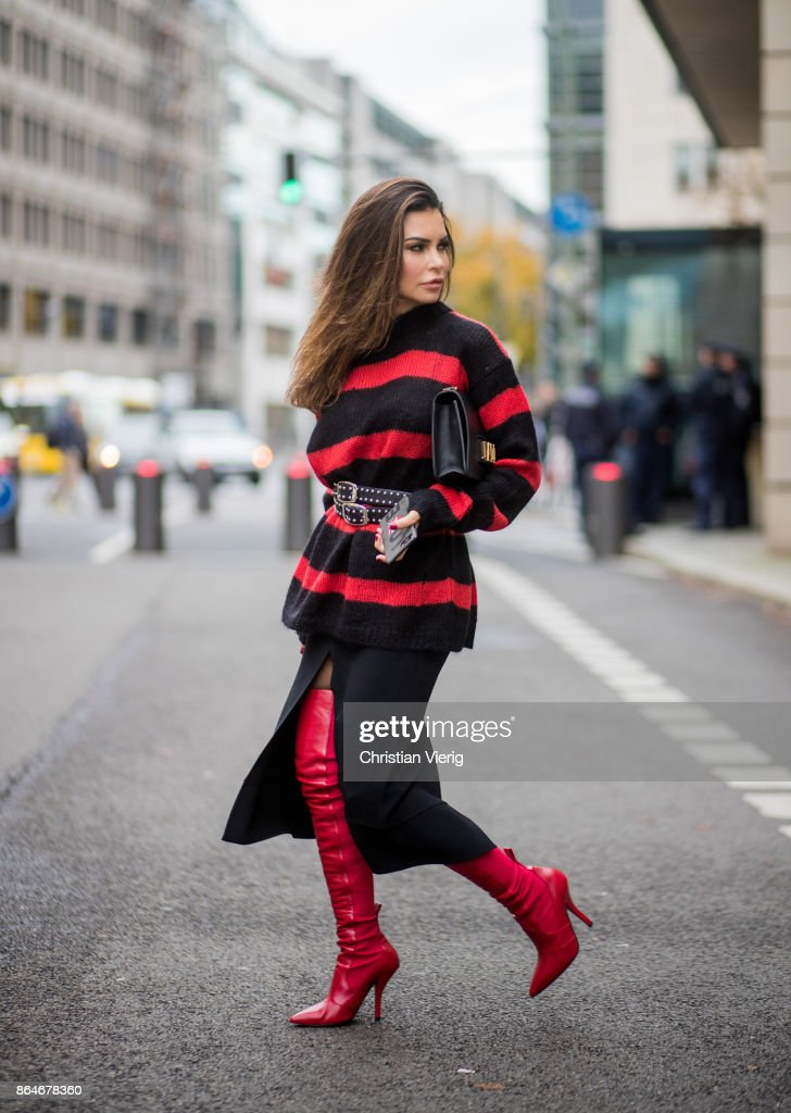 Miryam Labiad wearing red black striped Faith Connexion knit, Chloe skirt, black Rodarte belt, Dior hand bag, red Fendi overknee boots on October 21, 2017 in Berlin, Germany.