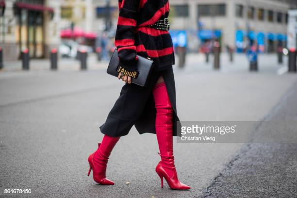 Miryam Labiad wearing red black striped Faith Connexion knit Chloe skirt black Rodarte belt Dior hand bag red Fendi overknee boots on October 21 2017...
