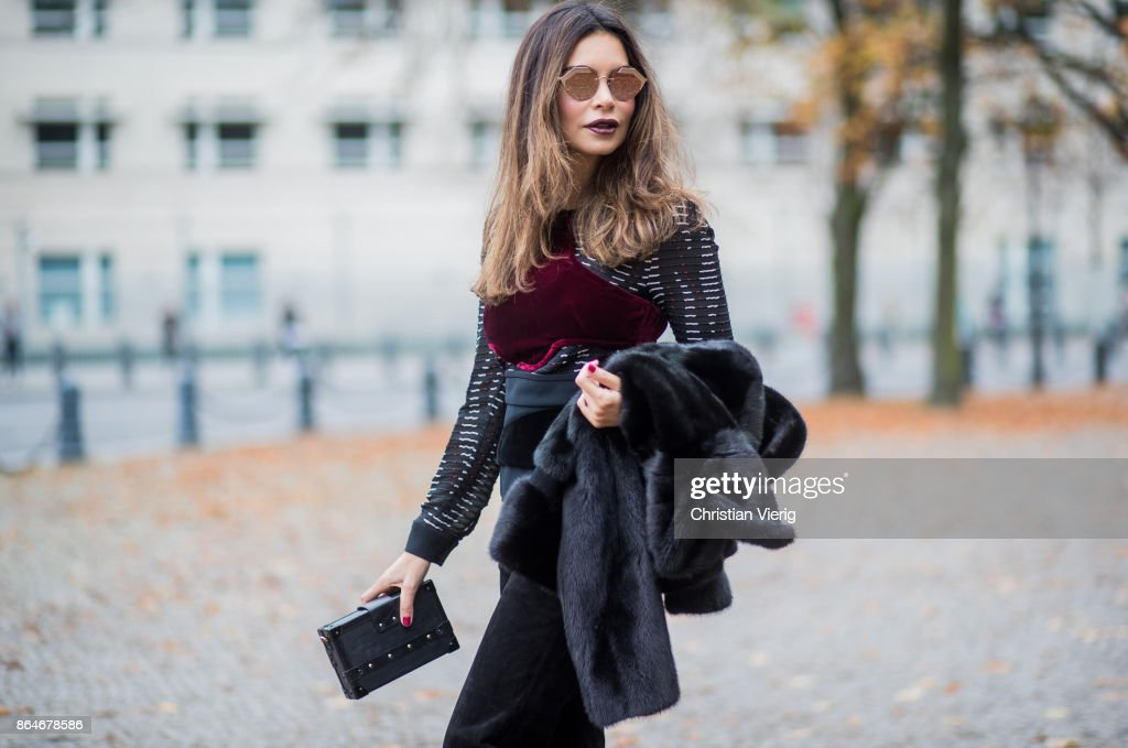 Miryam Labiad wearing Roland Mouret top and pants, black Celine fur jacket, Louis Vuitton clutch, Bulgari sunglasses on October 21, 2017 in Berlin, Germany.