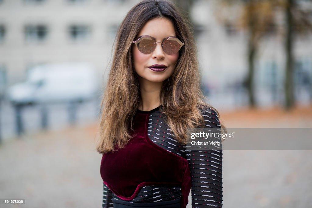 Miryam Labiad wearing Roland Mouret top and pants, black Celine fur jacket, Louis Vuitton clutch, Bulgari sunglasses on October 21, 2017 in Berlin, Germany.
