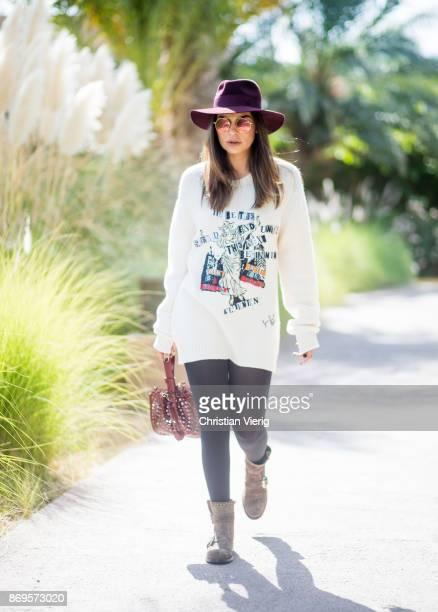 Miryam Labiad wearing Valentino knit with print Maison Michel hat Alaia bag Jimmy Choo bots sunglasses on November 2 2017 in Marrakech Morocco