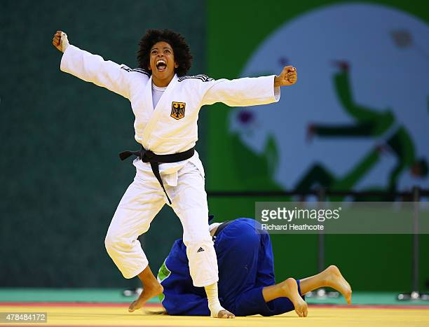 Miryam Roper of Germany celebrates victory over Automne Pavia of France in the Women's Judo 57kg Bronze Final during day thirteen of the Baku 2015...