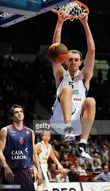 Mirza Begic #15 of Zalgiris Kaunas competes with Pau Ribas #4 of Caja Laboral during the Turkish Airlines Euroleague Day 4 game between Caja Laboral...