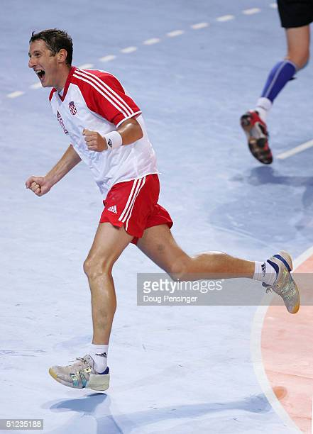 Mirza Dzomba of Croatia celebrates scoring a goal in the men's handball gold medal match between Gemany and Croatia on August 29 2004 during the...