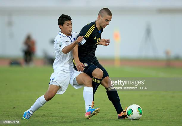 Mirza Halvadzic of Sweden holds off Brayan Velasquez of Honduras during the FIFA U17 World Cup UAE 2013 Quarter Final match between Honduras and...