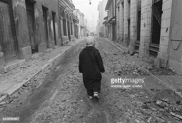 Mirza Mangajic a 10yearold Muslim boy walks in the street He survives in Sarajevo's Old Town quarter with his grandmother He has no news of his...