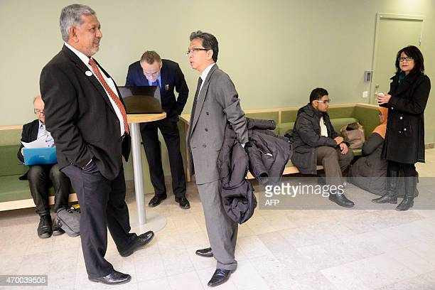 Mirza Mohammad Taiyab Director General Tourism Malaysia and Badruddin AbRahman Malaysian embassador in Sweden await the opening of the trial against...