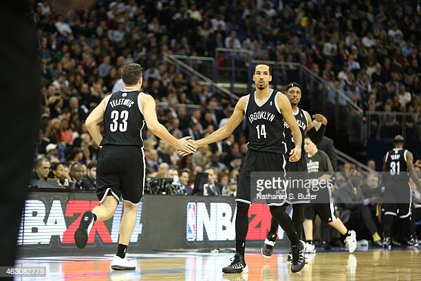 Mirza Teletovic and Shaun Livingston of the Brooklyn Nets celebrates against the Atlanta Hawks as part of the 2014 Global Games on January 16 2014 at...
