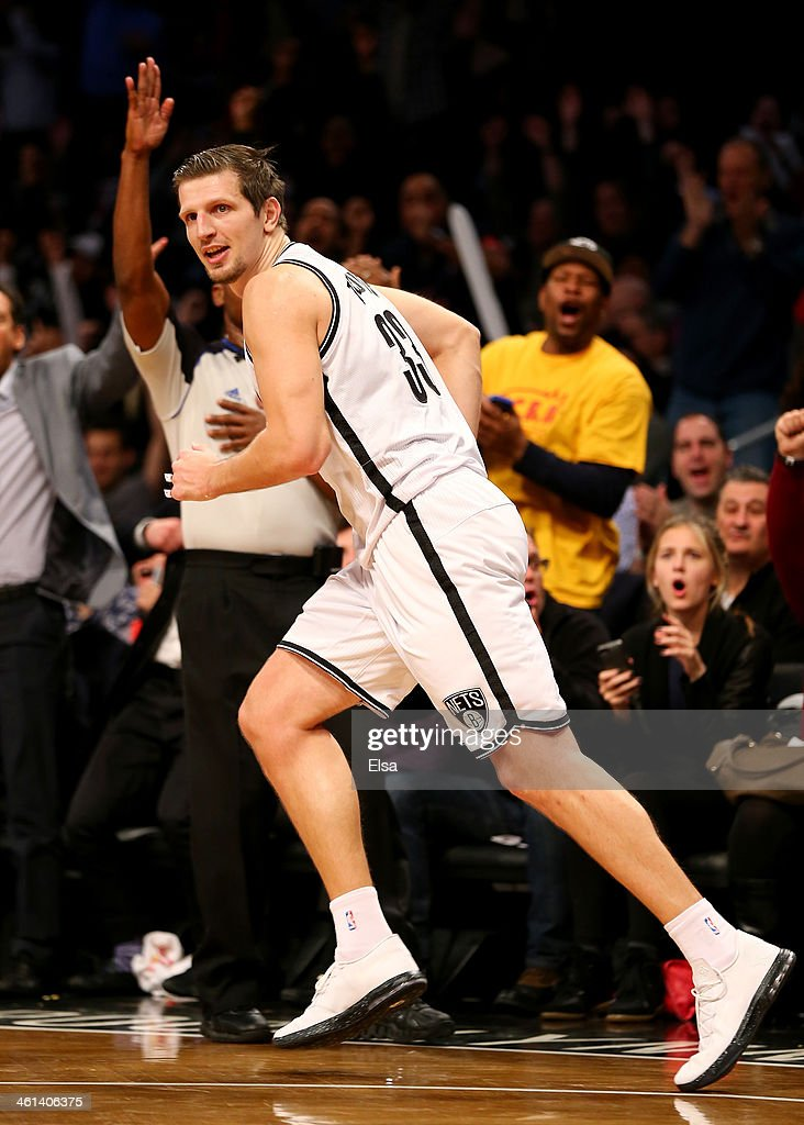 Mirza Teletovic #33 of the Brooklyn Nets celebrates his three point shot in the fourth quarter against the Atlanta Hawks at the Barclays Center on January 6, 2014 in the Brooklyn borough of New York City.The Brooklyn Nets defeated the Atlanta Hawks 91-86.
