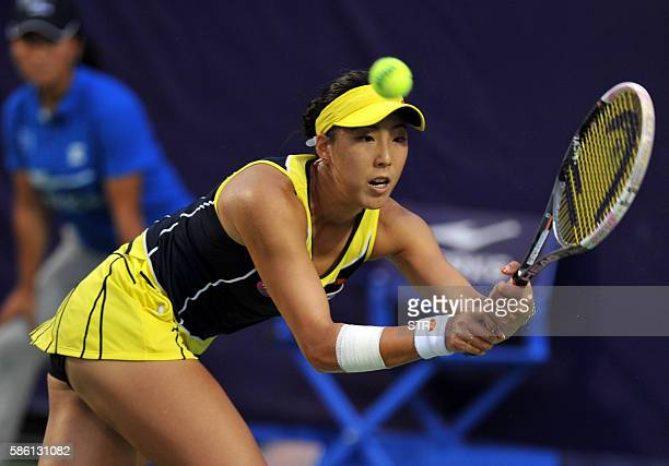 Misa Eguchi of Japan hits a return against Liu Fangzhou of China during their singles quarterfinal match at the Jiangxi Open WTA tennis tournament in...