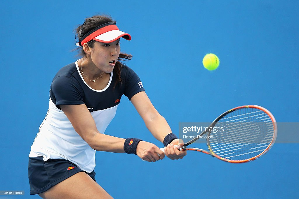 Misa Eguchi of Japan plays a backhand in her qualifying match against Katarzyna Piter of Poland for 2015 Australian Open at Melbourne Park on January 16, 2015 in Melbourne, Australia.