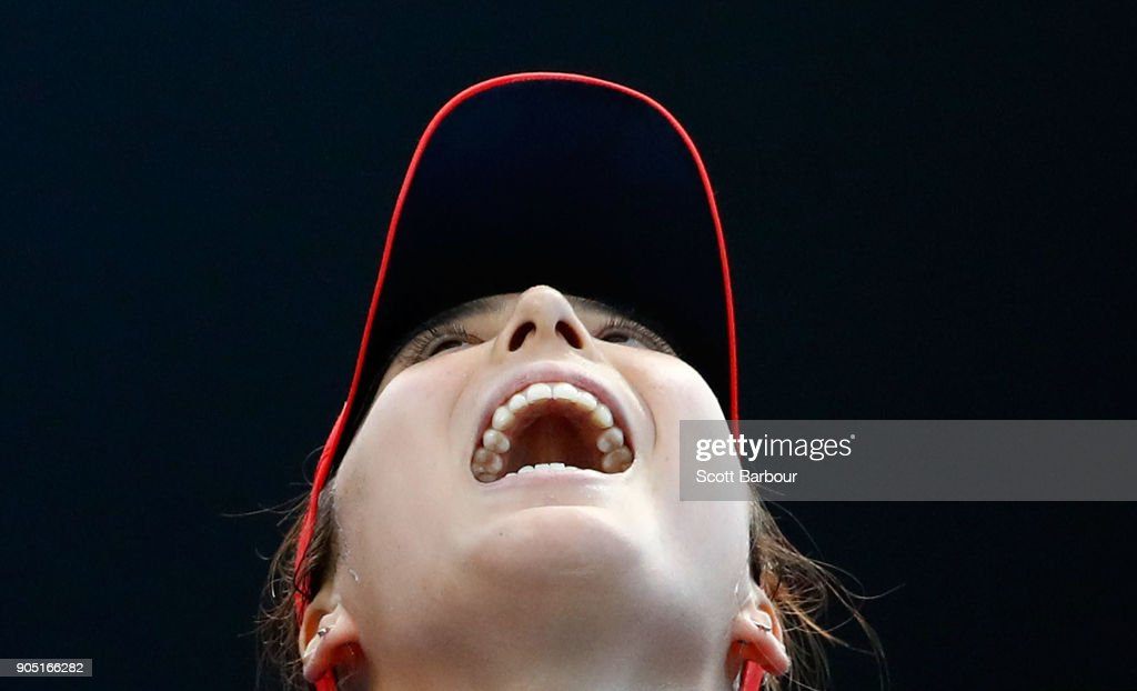 Misa Eguchi of Japan reacts in her first round match against Jana Fett of Croatia on day one of the 2018 Australian Open at Melbourne Park on January 15, 2018 in Melbourne, Australia.