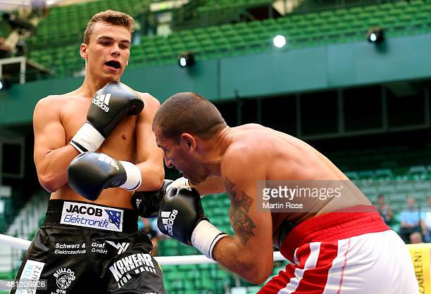 Misa Nikolic of Serbia exchange punches with Leon Bauer of Germany during the super middleweight fight at Gerry Weber Stadium on July 18 2015 in...