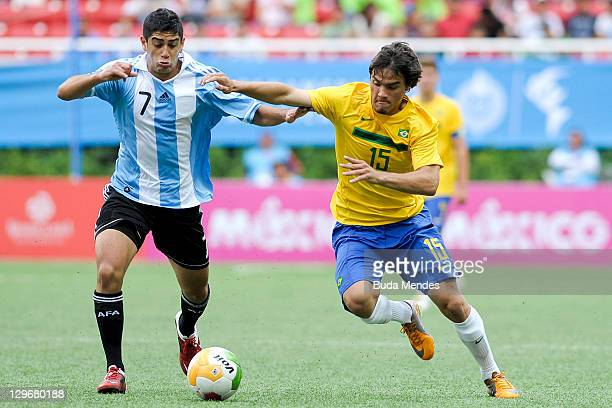 Misael Bueno of Brazil struggles for the ball with Matias Laba of Argentina during a match as part of XVI Pan American Games at Ominilife stadium on...