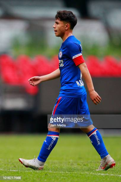 Misael Dominguez of Cruz Azul leaves the pitch after receiving a red card during the match between Cruz Azul v Atlas at Azteca Stadium on August 8...