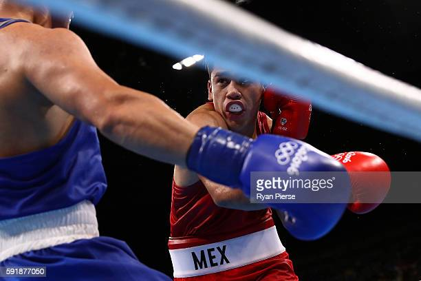 Misael Uziel Rodriguez of Mexico fights against Bektemir Melikuziev of Uzbekistan during a Men's Middle Semifinal bout on Day 13 of the 2016 Rio...