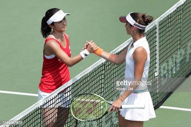 Misaki Doi of Japan and Bibiane Schoofs of the Netherlands shake hands after their singles match on day two of the Fed Cup World Group II Playoff...