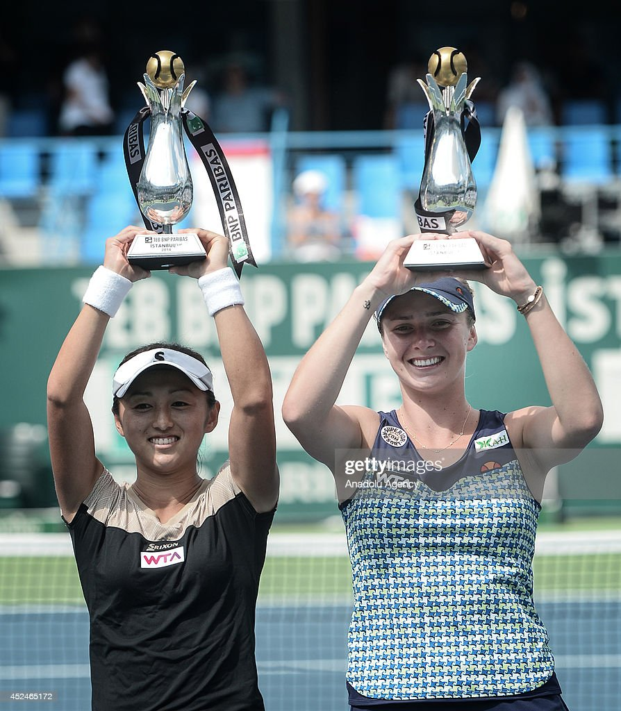 Misaki Doi (L) of Japan and Elina Svitolina (R) of Ukraine win the final doubles match at TEB PNP Paribas Istanbul Cup doubles final match at Koza World of Sports Arena in Istanbul, Turkey on July 20, 2014.