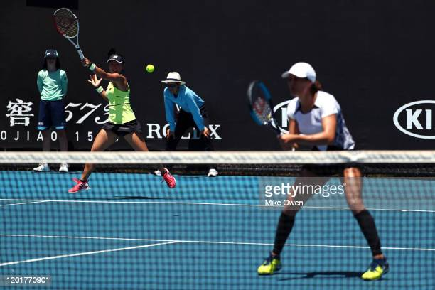 Misaki Doi of Japan and Monica Niculescu of Romania play in their Women's Doubles second round match against Nao Hibino and Makoto Ninomiya of Japan...