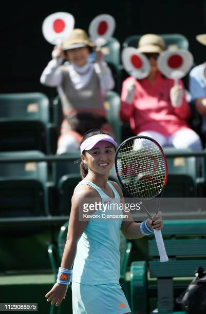 Misaki Doi of Japan celebrates after defeating Ons Jabeur of Tunisia during the ladies singles first round match on day four of the BNP Paribas Open...