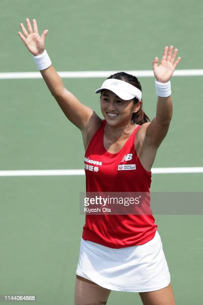 Misaki Doi of Japan celebrates after winning her singles match against Bibiane Schoofs of the Netherlands on day two of the Fed Cup World Group II...