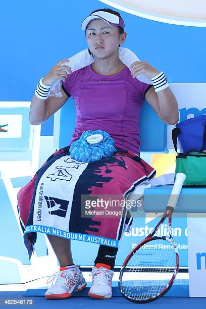 Misaki Doi of Japan cools off during a break in her first round match against Jelena Jankovic of Serbia during day two of the 2014 Australian Open at...