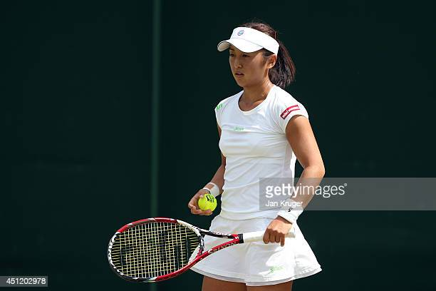 Misaki Doi of Japan during her Ladies' Singles second round match against Ekaterina Makarova of Russia on day three of the Wimbledon Lawn Tennis...