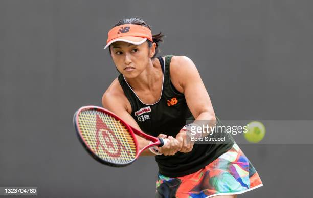 Misaki Doi of Japan hits a backhand against Angelique Kerber of Germany in the women's singles match during day 4 of the bett1open at LTTC Rot-Weiß...