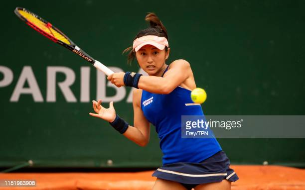 Misaki Doi of Japan hits a backhand to Sloane Stephens of the United States during her 63 76 loss in the first round of the women's singles during...
